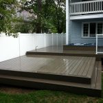 water resistant composite deck with hottub
