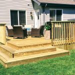 pressure treated lumber deck with a patio set