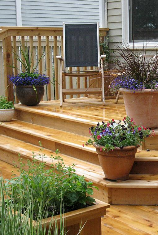 custom cedar deck with flower pots