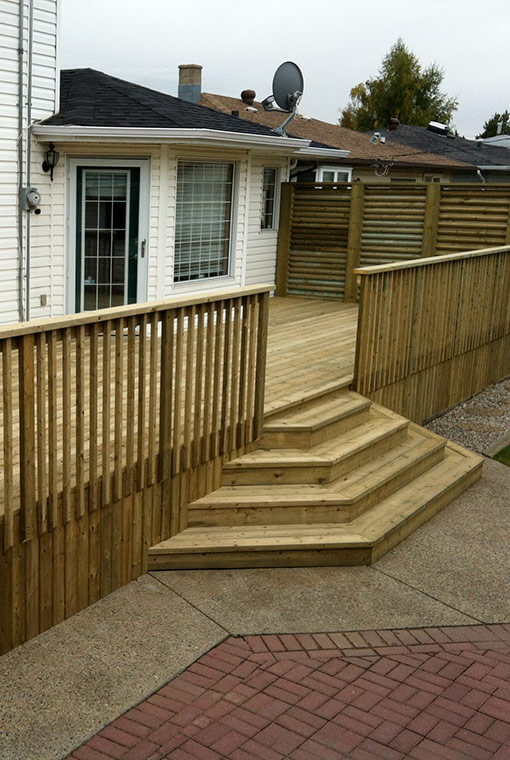 Pressure treated lumber deck with 4 steps and railing