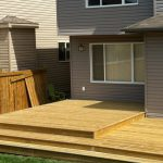 Pressure treated lumber back deck