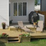 Pressure treated lumber deck with reclining chairs